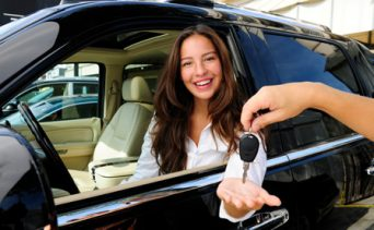 Woman purchasing a new car