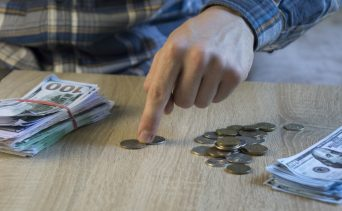 Counting out money for savings